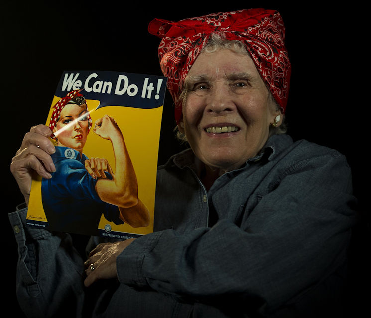 "February 9, 2017 - Margaret ""Peggy"" Wills, B-24 electrician during World War II, holds a recruitment poster at Minot Air Force Base in North Dakota. Wills was a Rosie the Riveter at Holman Field in St. Paul, Minnesota. (U.S. Air Force photo by Senior Airman Apryl Hall)"