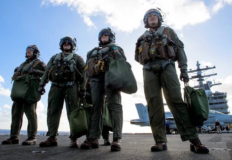 July 30, 2017 - Pilots stand on the flight deck of the aircraft carrier USS Ronald Reagan. (U.S. Navy photo by Mass Communication Specialist Kenneth Abbate)