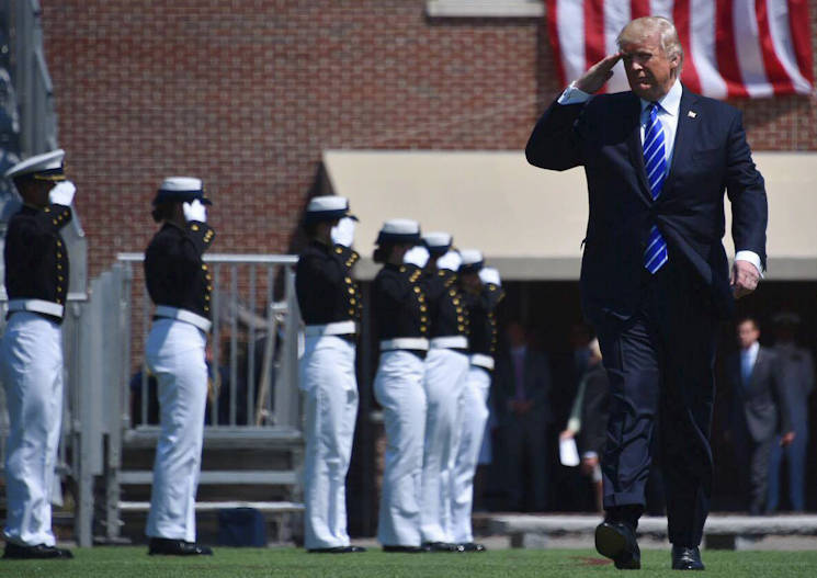 May 17, 2017 - President Donald J. Trump salutes the 195 cadets during the 136th U.S. Coast Guard Academy Commencement in New London, CT. Each year, the president delivers the commencement address at one of the U.S. military service academies. This was the first time Trump addressed a service academy graduating class as commander in chief. (U.S. Coast Guard photo by Petty Officer 2nd Class Patrick Kelley)