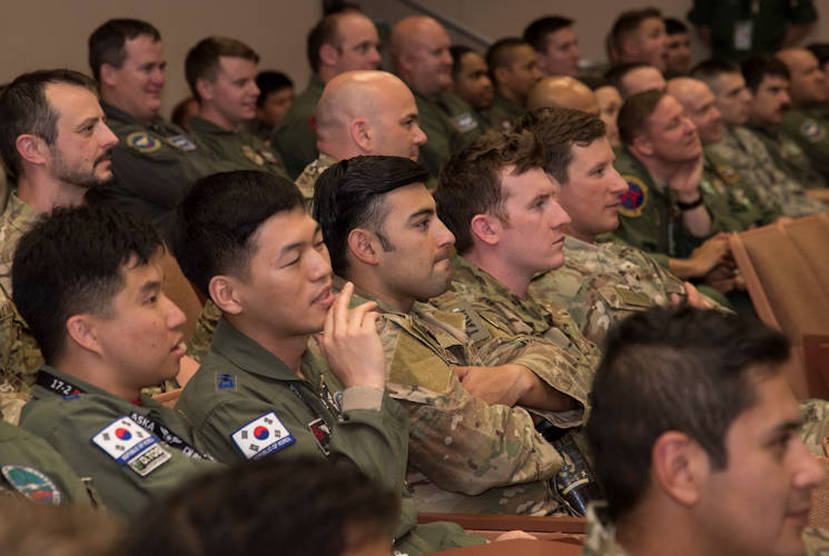 June 7, 2017 - Pilots listen to a mass briefing during the large force exercise Red Flag-Alaska 17-2 at Eielson Air Force Base, Alaska. U.S. service members from all branches and several air forces from other countries including the Royal Thai, Republic of Korea, Japan Air Self-Defense Force, Finland, Denmark and Israel's air forces. They worked together to improve their tactical fluidity as they work cohesively, executing the objective. Exercises of this nature are vital to maintaining peace and stability in the Indo-Asia-Pacific theatre and signifies our continued commitment to the Pacific. (U.S. Air Force photo by Airman 1st Class Sadie Colbert)