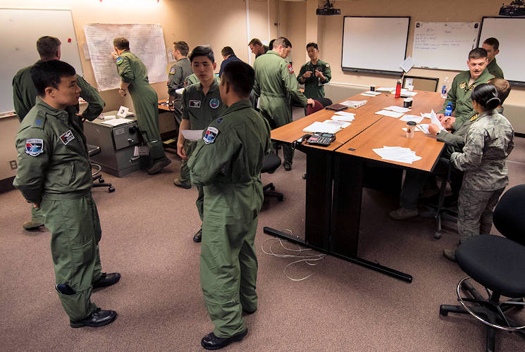 June 12, 2017 - Republic of Korea Air Force, U.S. Air Force and Japan Air Self-Defense Force members begin mission planning during RED FLAG-Alaska (RF-A) 17-2 at Eielson Air Force Base, Alaska. RF-A is a two-week, multilateral large force exercise with many other nations, including Denmark, Finland and Israel, who participate to better overall tactics as one cohesive unit. (U.S. Air Force photo by Airman 1st Class Sadie Colbert)