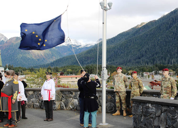October 18, 2017 - Reenactors portray Russian Empire delegates who stand aside while U.S. Army Civil War-era Soldiers raise the Alaska state flag at Castle Hill during the 2017 Alaska Day Festival, Sitka, Alaska. This ceremony honors the 150th anniversary of the transfer of Russian America from Russia to the United States. U.S. Army Alaska Soldiers with 725th Brigade Support Battalion (Airborne), 4th Infantry Brigade Combat Team (Airborne), 25th Infantry Division provided a color guard and firing squad while Arctic Support Command's 9th Army Band, 17th Combat Sustainment Support Battalion provided instrumental music. (U.S. Army photo by Capt. Richard Packer)