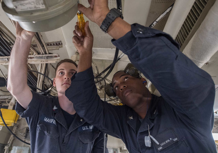 September 18, 2017 - Electrician's Mates 3rd Class Peter Oculien, right, a Navy reservist from Ocala, Fla., and Michael Mansfield from Apopka, Fla., install a gyro repeater in the main control room aboard the amphibious dock landing ship USS Ashland (LSD 48). Ashland is operating in the Indo-Asia-Pacific region to enhance interoperability with partners and serve as a ready-response force for any type of contingency. (U.S. Navy photo by Petty Officer 3rd Class Jonathan R. Clay)