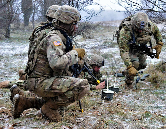 Engineers of Lightning Troop, 3rd Squadron, 2nd Cavalry Regiment, assigned to the Battle Group Poland, set up the detonation cords for breach operations during Dire Wolf II, platoon live-fire exercise near Bemowo Piskie Training Area, Poland, Dec. 14, 2017. These soldiers are part of a unique, multinational battle group made up of U.S., British, Croatian and Romanian soldiers serving with the Polish 15th Mechanized Brigade as a deterrence force in northeastern Poland in support of NATO's enhanced forward presence. (U.S. Army photo by Capt. Gary Loten-Beckford)