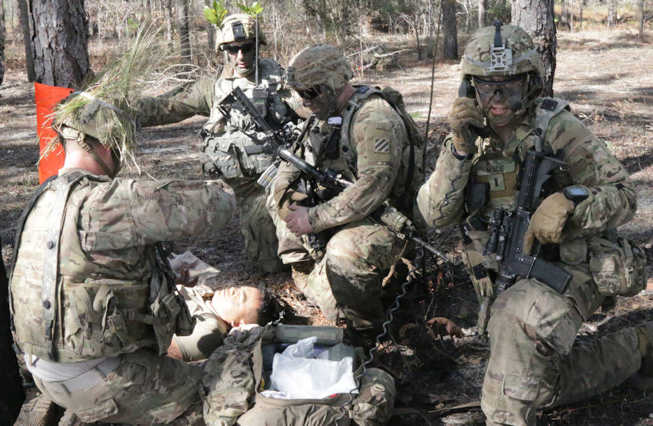 January 27, 2017 - U.S. Army Soldiers assigned to Bravo Company, 3rd Battalion, 15th Infantry Regiment, 2nd Infantry Brigade Combat Team on Ft. Stewart, treat a casualty during their live fire exercise. The Soldiers air assaulted out to the training area, established a support by fire, and moved across the range to clear their objective as part of their exercise China Focus. (U.S. Army photo by Spc. Elizabeth White, 50th Public Affairs Detachment)