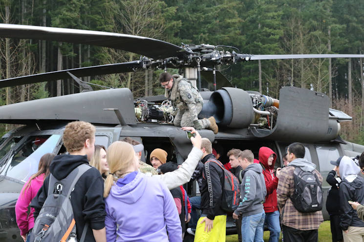 December 13, 2016 - Chief Warrant Officer 2 Sean Quillin carefully navigated his UH-60 Black Hawk helicopter above a crowd of wind-swept high school kids. Below him was the wide open gridiron of Emerald Ridge High School's football field. (Courtesy photo by Jennifer Picardo)