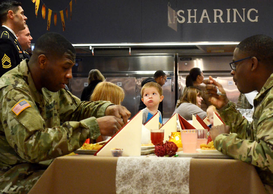 November 22, 2017 - Soldiers, along with other family members, from the Joint Multinational Readiness Center, enjoy their Thanksgiving meal at the Warrior Sports Cafe Dining Facility in Hohenfels, Germany. (U.S. Army photo by Staff Sgt. David Overson)