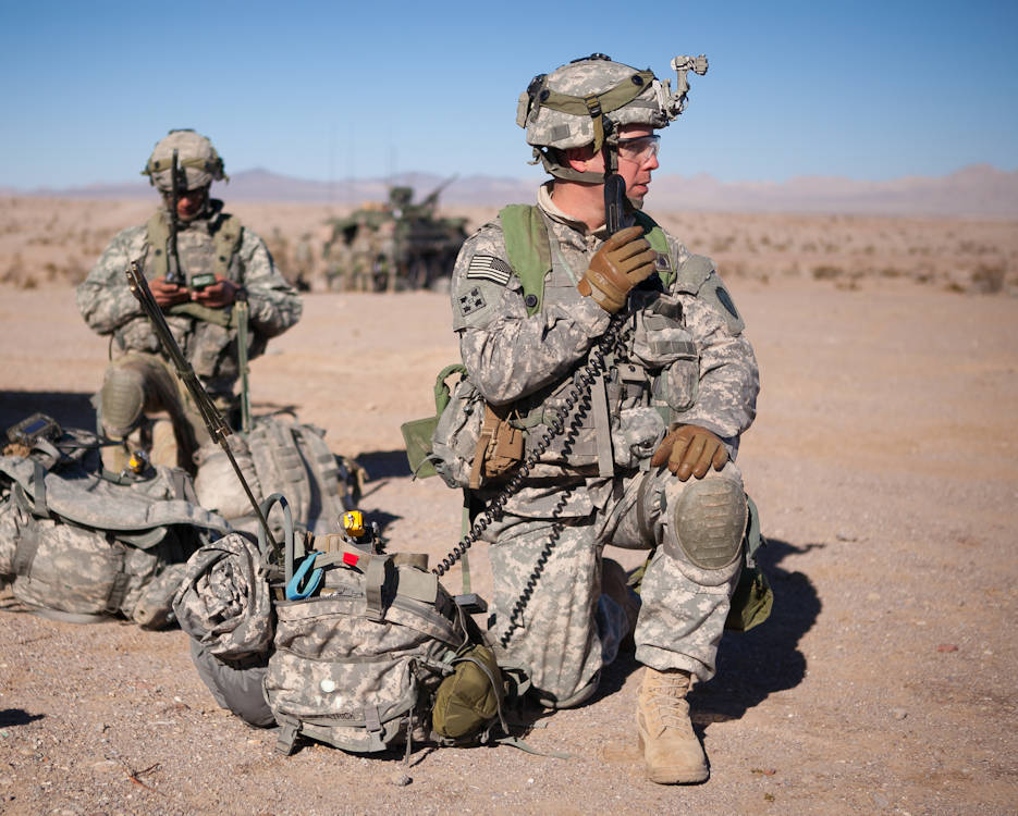 January 13, 2017 - U.S. Army Soldiers, 3rd Battalion, 21st Infantry Regiment, 1st Stryker Brigade Combat Team, 25th Infantry Division, communicate with radios during the training exercise, NTC 17-03, National Training Center, Ft. Irwin, CA. The National Training Center conducts tough, realistic, Unified Land Operations with our United Action Partners to prepare Brigade Combat Teams and other units for combat while taking care of Soldiers, Civilians, and Family members. (U.S. Army Photo by Sgt. Jason A. Young)