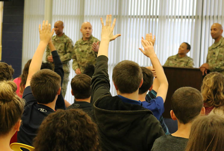 November 8, 2017 - Buckhorn Middle School students raise their hands to ask questions during a class session with Soldiers from the Aviation and Missile Command. The Soldiers shared their experiences of military service and answered questions running the gamut from the insignia on their uniforms to how dangerous it is to be an airborne Soldier. (U.S. Army photo by Kari Hawkins, Aviation & Missile Command)