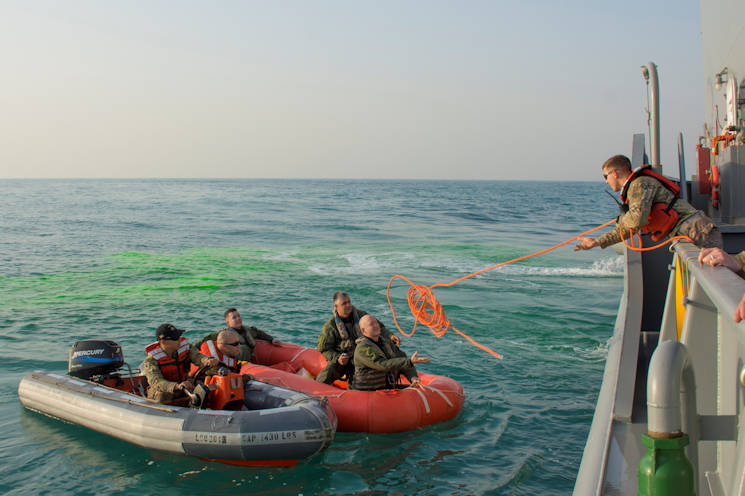 February 13, 2017 - Soldiers with Bravo Company, 1-111th Aviation Regiment, Florida, and 77th Combat Aviation Brigade, Arkansas, grab a rescue rope while participating in a personnel recovery mission with the crew of LCU2013 Churubusco, a Landing Craft Utility vessel from Detachment 1, 481st Transportation Company, California, in an exercise replicating a downed aircraft off the coast of Kuwait. (U.S. Army photo by Sgt. 1st Class Suzanne Ringle)