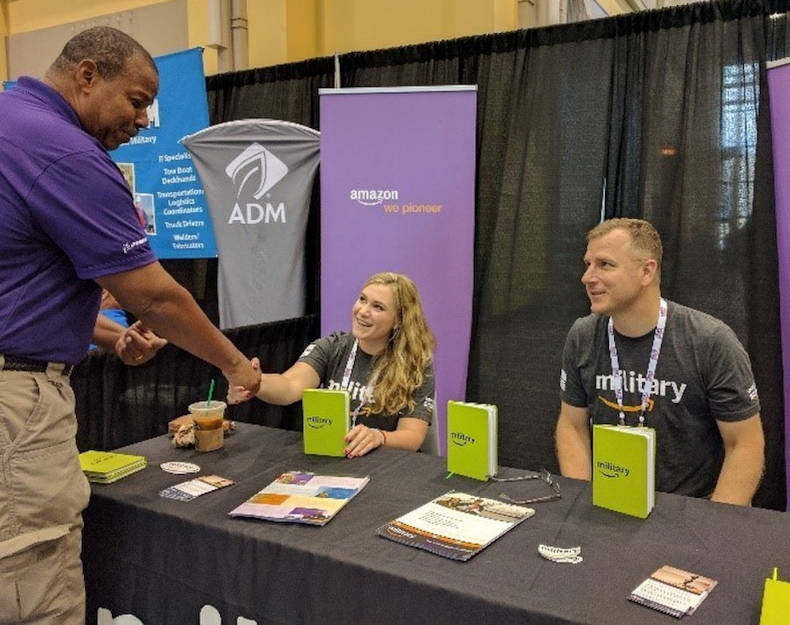 Army Capt. (ret) Tim Bomke and his Military Programs Coordinator Sarah Martin share Amazon job opportunities at the 2017 Department of Defense Warrior Games in Chicago during June. (Photo courtesy of Tim Bomke)