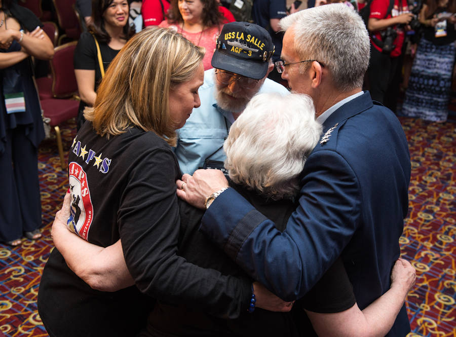 Ms. Bonnie Carroll, TAPS President and Founder, left, and U.S. Air Force Gen. Paul J. Selva, Vice Chairman of the Joint Chiefs of Staff, right, embrace the mother and father of U.S. Navy Electronics Technician 1st Class Ronald Hemenway after the Tragedy Assistance Program for Survivors (TAPS) Grand Banquet at the 23rd TAPS National Military Survivor Seminar and Good Grief Camp in Arlington, VA on May 27, 2017. Hemenway's perished at the Pentagon during the Sept. 11th terrorist attacks. (DoD Photo by U.S. Army Sgt. James K. McCann)