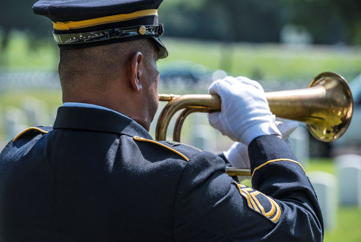 "Taps is played during the interment of U.S. Army Air Forces Staff Sgt. William ""Blootie"" Turner at the Nashville National Cemetery located in Madison, Tenn., August 22, 2017. Turner was aboard a B-26 Marauder in December 1943, when the plane, nicknamed ""Hell's Fury,"" was shot down killing all on-board except the pilot. After years of painstaking work, Turner's remains were positively identified and he was given proper military burial honors. (U.S. Army photo by Master Sgt. Brian Hamilton)"