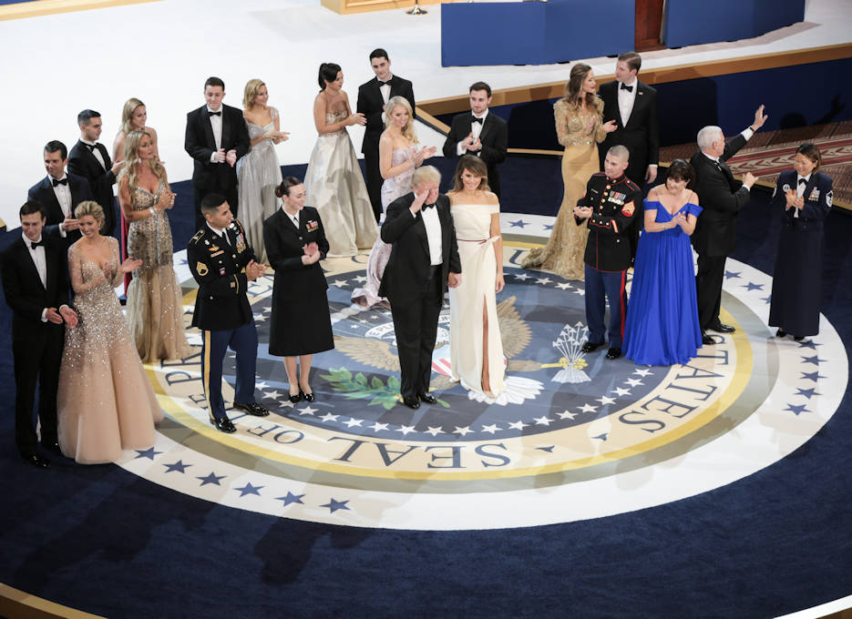 January 20, 2017 - President Donald J. Trump and Vice President Mike Pence salute the crowd during the Salute to Our Armed Services Ball at the National Museum, Washington, D.C. President Trump, the First Lady, Vice President Pence, and the Second Lady also danced with service members on the floor with them and their families. The event, one of the three official balls held in celebration of the 58th Presidential Inauguration, paid tribute to members of all branches of the armed forces of the United States, as well as first responders and emergency personnel. (DoD photo by U.S. Army Spc. Abigayle Marks)