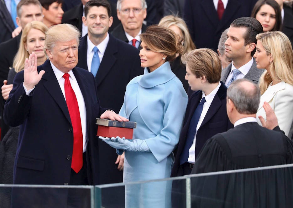 January 20, 2017 - Donald J. Trump with his wife, Melania, proudly holding Abraham Lincoln's bible on top of Donald Trump's personal bible given to him by his mother ... takes the Oath of Office as the 45th President of the United States of America by Supreme Court Chief Justice Roberts, as the rest of his family, Vice President Mike Pence, former Presidents, other elected officials, dignitaries, and millions of fellow Americans witness in person and on television. (Photo courtesy of The White House)