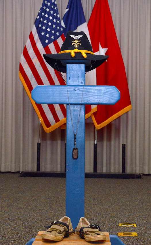 January 24, 2017 - Texas Military Department conducts final roll call ceremony, for the honorary Texas Army National Guard Spc. Rowan Jameson Windham at Camp Mabry in Austin, Texas. Traditionally, the ceremony includes a visible reminder of the deceased soldier. In this case a wooden cross and gear stand, signals a time for prayer, a break in action to pay tribute to their comrade. (U.S. Army National Guard photo by Sgt. Elizabeth Pena)