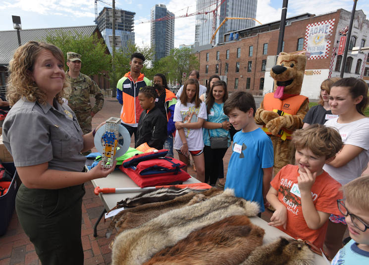 "April 14, 2017 - Cordell Hull Lake Park Ranger Ashley Webster gives a presentation on hydropower, water safety and natural resources to kids participating in the district's ""Take Your Kids to Work Day"" activities at Riverfront in Nashville, TN. (U.S. Army Corps of Engineers photo by Leon Roberts)"
