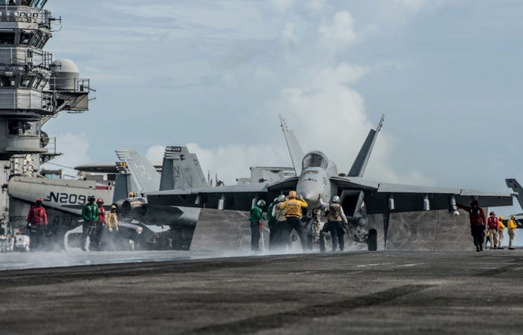 "September 15, 2016 - Sailors maneuver an F/A-18E Super Hornet on the flight deck of the Navy's only forward-deployed aircraft carrier USS Ronald Reagan (CVN 76) during Valiant Shield 2016. Naval Surface Warfare Center Dahlgren Division (NSWCDD) scientist Dr. Mary Ann Cummings - who won the 2016 Naval Sea Systems Command Scientist of the Year Award - used her innovation called Orchestrated Simulation through Modeling (OSM) while embarked on the Reagan throughout Valiant Shield. ""We used the OSM framework during the exercise to provide Sailors with a powerful tool for warfare simulations and more realistic at-sea training,"" said Cummings, adding that the patented technology is available to Department of Defense personnel for military programs and exercises. (Photo by U.S. Navy photo by Mass Communication Specialist 3rd Class Nathan Burke)"