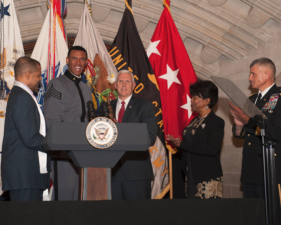 February 9, 2017 - West Point Cadet Christian Nattiel, the U.S. Military Academy's first African American Rhodes Scholar, and retired Army Major Pat Locke, the first female African American USMA graduate, present a bust to Vice President Mike Pence during the Lieutenant Henry O. Flipper Dinner at the academy in West Point, New York. The annual dinner is held to commemorate the life of Henry O. Flipper, the first African American graduate of West Point. (U.S. Army photo by Carmine Cocchia)