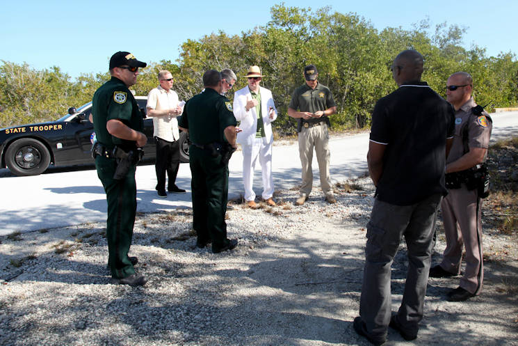 February 3, 2017 - A psychological operations Paratrooper role-playing the embassy security officer, shown center in a white suit, negotiates for the release of the detained broadcast teams from Monroe County Sheriff's Office Deputies, role-playing a Conch Republic police officer. Local law enforcement of Monroe County, Florida, participated in Operation Warrior Anvil, a validation exercise held in Key West, Florida, by 7th Military Information Support Battalion, 4th Military Information Support Group. The exercise validated teams through unparalleled training with joint, inter-agency, and civic partners in real-world urban environments that reinforced PSYOP fundamentals, fostered teamwork, and strengthened character. (U.S. Army photo by Capt. Stephen Von Jett)