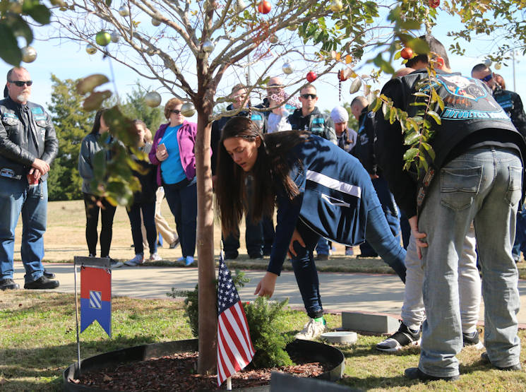 December 16, 2017 - Families, friends and the Marne community both on and off the installation pay their respects and lay a wreath down for fallen Soldiers at Fort Stewart, Georgia. Wreaths for Warriors Walk was a program established 11 years ago, that invites families of fallen Soldiers, the local community as well as Soldiers at Ft. Stewart to place a Christmas wreath at the trees of fallen 3rd ID Soldiers along the Warriors Walk at Cottrell Field in a solemn memorial service. (U.S. Army photo by Sgt. Arjenis Nunez)