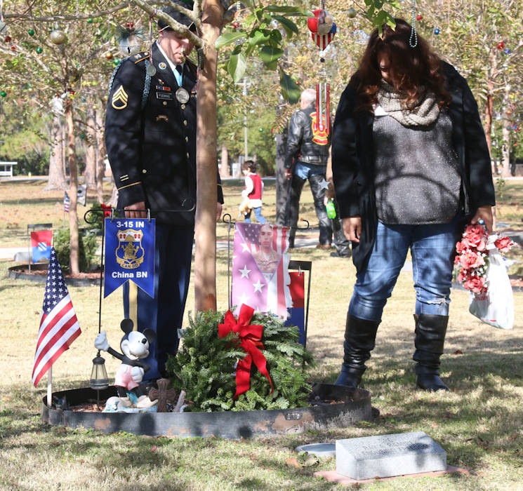 December 16, 2017 - Staff Sgt. Earl N. Fleming assigned to 3rd Battalion, 15th Infantry Regiment, 15th Armored Brigade Combat Team, 3rd Infantry Division and Angelina Bueno Ramirez, mother of a fallen Soldier and friend to Fleming, lay a wreath at the memorial for her son Spc. Ray A. Ramirez at Fort Stewart, Georgia. Spc. Ramirez was an infantryman assigned to 3-15, 15th Armored Brigade Combat Team when he was killed in action four and a half year ago on December 1st. (U.S. Army photo by Sgt. Arjenis Nunez)