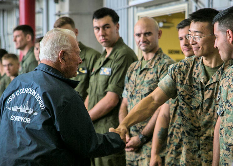 April 7, 2017 - Donald Irwin, a U.S. Navy veteran of World War II, shakes Lance Cpl. Hui Xue's hand on Marine Corps Air Station Futenma, Okinawa, Japan. Irwin, who served aboard a number of ships during World War II, fought at Midway and Guadalcanal and survived the sinking of the USS Colhoun during the Battle of Okinawa. Irwin returned to Okinawa and exchanged stories with the Marines and Sailors stationed on the island. Irwin is a San Jose, California native, and Xue, a native of New York, is an aviation life support system technician with Marine Medium Tiltrotor Squadron 265, Marine Aircraft Group 36, 1st Marine Aircraft Wing, III Marine Expeditionary Force(U.S. Marine Corps photo by Cpl. Amaia Unanue)
