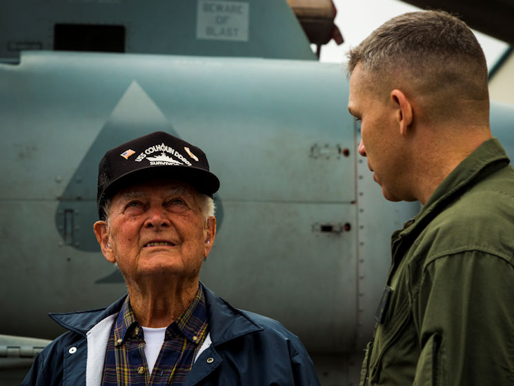April 7, 2017 - Lt. Col. Bryan G. Swenson gives Donald Irwin, a United States Navy World War II veteran, a tour of the MV-22 Osprey on Marine Corps Air Station Futenma, Okinawa, Japan. Irwin took part in battles for Midway, Guadalcanal, and survived the sinking of the USS Colhoun during the battle for Okinawa. Irwin decided to return to Okinawa and exchange stories with the Marines and Sailors stationed on the island. Swenson, a Kansas City, Missouri, native, is the commanding officer of Marine Medium Tiltrotor Squadron 265, Marine Aircraft Group 36, 1st Marine Air Wing, III Marine Expeditionary Force. Irwin is a native of San Jose, California. (U.S. Marine Corps photo by Lance Cpl. Joshua Pinkney)