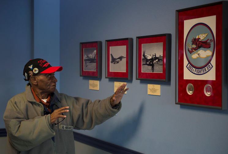 Army Air Corps Staff Sgt. Leslie Edwards, a Tuskegee Airman of the 617th Bombardment Squadron, tours the 302d Fighter Squadron at Joint Base Elmendorf-Richardson, Alaska, Oct. 14, 2017. The 617th Bombardment Squadron was one of four Tuskegee Airmen bomber squadrons during World War II that made up the 477th Bombardment Group. In 2007, the 477th Bombardment Group became the 477th Fighter Group, bringing with it the legacy of Tuskegee airmen to Alaska. (U.S. Air Force photo by Senior Airman Javier Alvarez)