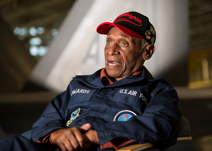 Army Air Corps Staff Sgt. Leslie Edwards, a Tuskegee Airman of the 617th Bombardment Squadron, speaks with historians at Joint Base Elmendorf-Richardson, Alaska, Oct. 14, 2017. The 617th Bombardment Squadron was one of the four Tuskegee Airmen bomber squadrons during WWII that made up the 477th Bombardment Group. In 2007, the 477th Bombardment Group became the 477th Fighter Group, bringing with it the legacy of Tuskegee Airmen to Alaska. (U.S. Air Force photo by Senior Airman Curt Beach)