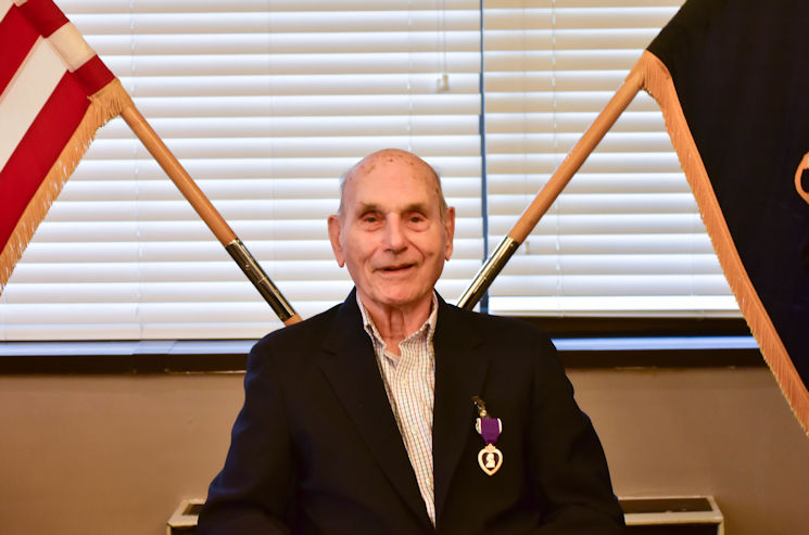 March 25, 2017 - Oscar L. Davis Jr. received the Purple Heart medal in Fayetteville, N. C. Davis Jr. was wounded during the Battle of the Bulge in 1944. (U.S. Army photo by Capt. John Moore)