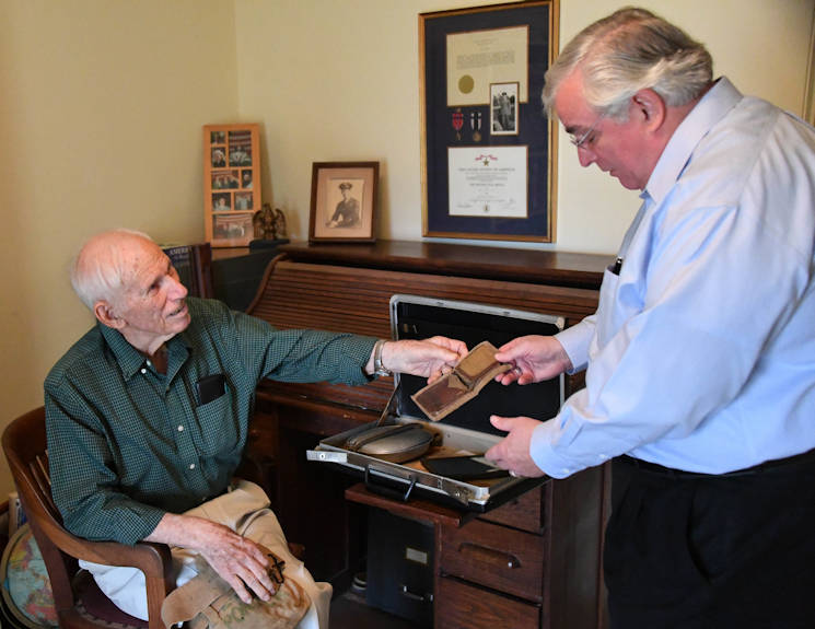 November 29, 2017 - Lloyd Ponder, World War II veteran, shares personal items he acquired while held as a prisoner of war in the Philippines during World War II, with William Callaway, Eighth Air Force historian, at his home in Natchitoches, Louisiana. Ponder recalls nearly all of his experiences during WWII and shared his story with the local community in hopes that people today will learn valuable lessons about what individuals endured during WWII, and how determination, hope and perseverance play vital roles to survival and success. (U.S. Air Force photo by Staff Sgt. Erin Trower)