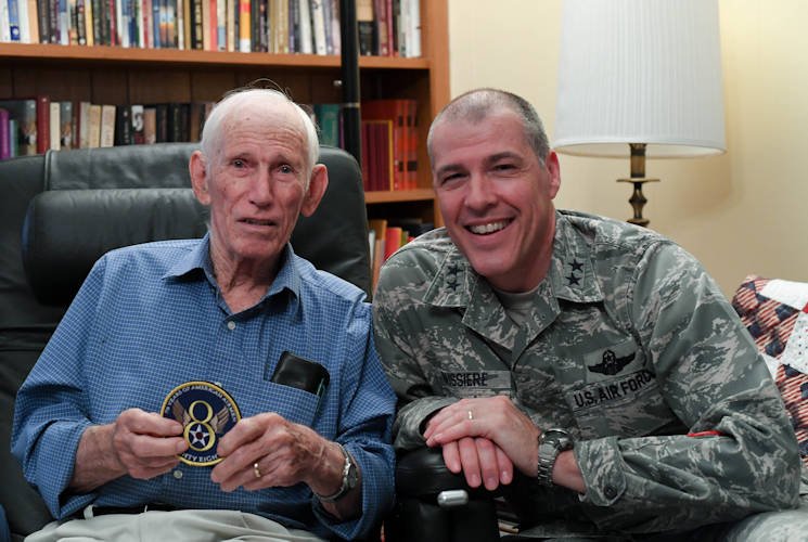 December 6, 2017 - U.S. Air Force Maj. Gen. Thomas Bussiere, Eighth Air Force commander, recognizes Lloyd Ponder, a World War II aircraft mechanic who was captured and held as a prisoner of war, at his home in Natchitoches, Louisiana. Bussiere presented Ponder with an Eighth Air Force 75th Anniversary patch and coin as a way to recognize him for his contributions and to personally thank him for the sacrifices he made. (U.S. Air Force photo by Staff Sgt. Erin Trower)