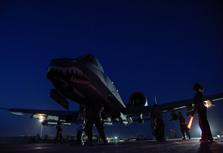 Crew chiefs from the 75th Expeditionary Fighter Squadron conduct pre-flight checks on an A-10C Thunderbolt II before take-off from Kandahar Airfield, Afghanistan, Aug. 2, 2018. The Airmen, from Moody Air Force Base, Georgia, are deployed in support of Operation Freedom's Sentinel by providing close-air support to Afghan forces and other coalition partners. (U.S. Air Force photo by Staff Sgt. Kristin High)