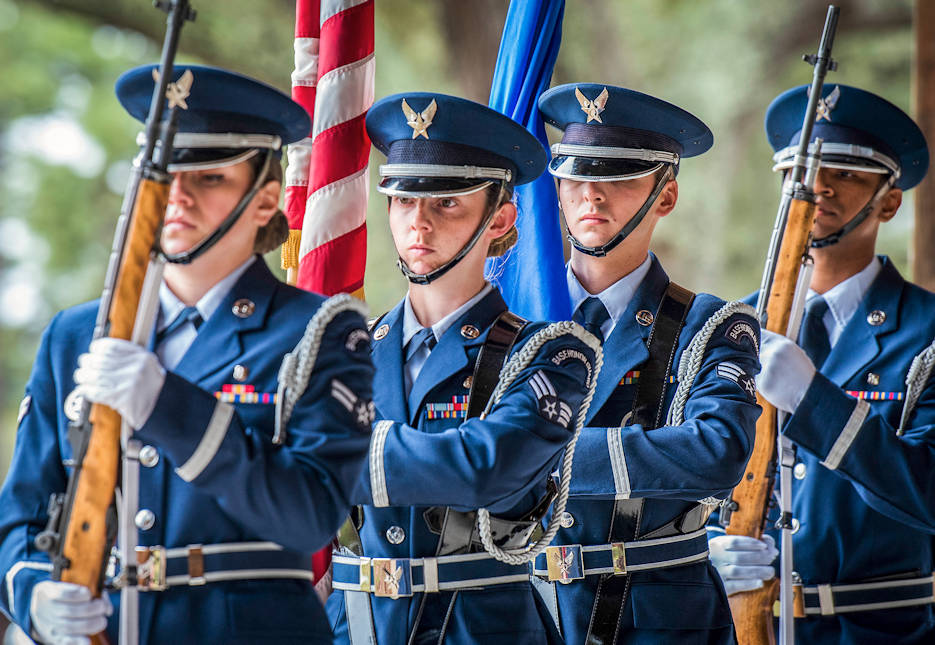 April 4, 2018 - A flag detail team brings in the colors during a full honors funeral ceremony at Eglin Air Force Base, Florida. The Air Force Honor Guard mobile training team visited the base to provide a 10-day standardized training course to 31 local honor guard Airmen. The goal is to ensure all honor guard units perform the required ceremonial procedures the same way throughout the Air Force. (U.S. Air Force photo by Samuel King Jr., Eglin Air Force Base Public Affairs)