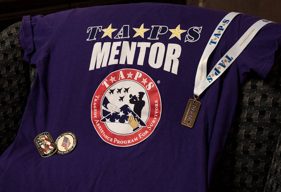 March 30, 2018 - U.S. Air Force Capt. Nathaniel Lee has attended several Tragedy Assistance Program for Survivors camps and conferences since entering the program as a child, and now as a mentor. Lee has collected memorabilia to commemorate several visits, and wears the purple TAPS shirt to symbolize his legacy role in the program. (U.S. Air Force photo by 2nd Lt. Scarlett Rodriguez)