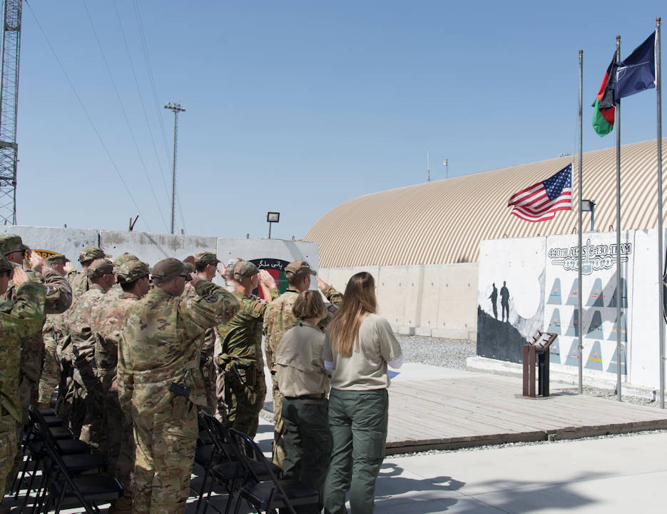 Members of the 438th Air Expeditionary Wing in Kabul, Afghanistan, gather to commemorate Memorial Day May 28, 2018. The day serves to honor military members currently serving and those that have died while in military service. Many Americans observe Memorial Day by visiting cemeteries and memorials with the U.S. flag usually flying at half-staff. (U.S. Air Force photo by Staff Sgt. Jared J. Duhon)