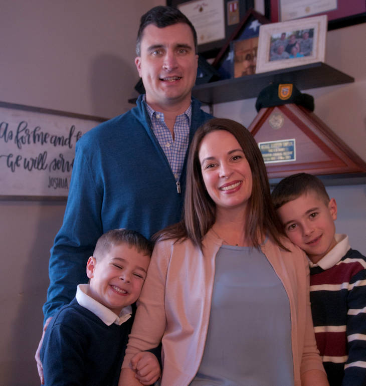 2018 Army Spouse of the Year recipient, Krista Anderson (center) poses for a photo surrounded by her family in her home in Olympia, Washington on February 25, 2018. Anderson was selected out of the top 18 other military spouses from Army installations around the world. Anderson, a Gold Star Spouse and wife to a current active duty Green Beret from 1st Special Forces Group (Airborne), is now in the running for the overall Military Spouse of the Year for all military branches. (U.S. Army Photo by Staff Sgt. Marcus Butler)