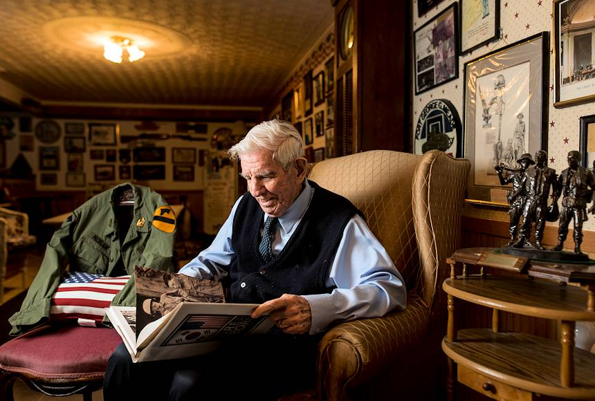 "January 18, 2018 - Sgt. Maj. (Ret.) Raymond Moran, affectionately known as the ""Old Soldier,"" flips through a book on the Korean War during a portrait session in the basement of his home in Odenton, Maryland, while sharing stories about his military commitment to the U.S. Army and the U.S. Army Reserve during 65 years of service both as an enlisted Soldier and as a Department of the Army civilian. Moran served in Korea, Vietnam, Japan, Cambodia and during Desert Storm. He was instrumental in standing up the 220th Military Police Brigade, which has since become the 200th Military Police Command and is the largest military police organization in the U.S. Department of Defense. (U.S. Army Reserve photo by Master Sgt. Michel Sauret)"