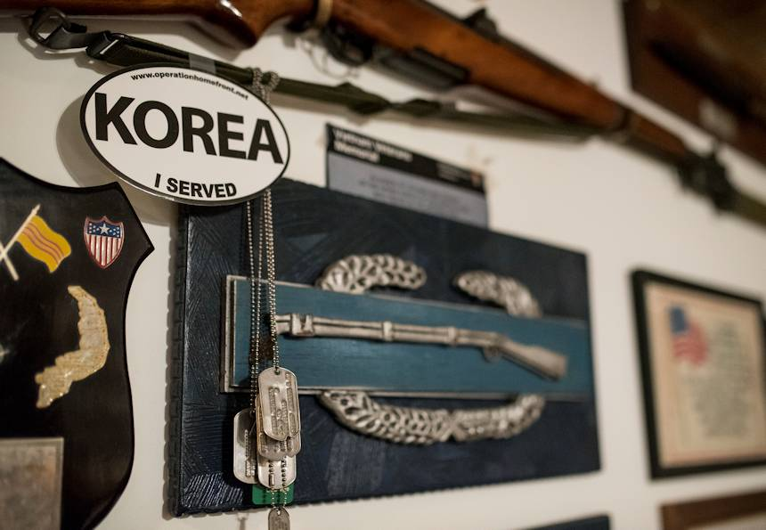 "February 22, 2018 - An oversized Combat Infantry Badge (CIB) hangs on the wall beneath a genuine M1 rifle in the basement of Sgt. Maj. (Ret.) Raymond Moran, affectionately known as the ""Old Soldier"", who lives in Odenton, Maryland. Moran earned the CIB in the Korean War. The rifle was a Veterans Day gift from his son. (U.S. Army Reserve photo by Master Sgt. Michel Sauret)"