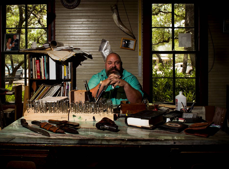 Former U.S. Army Sgt. Tony Fantasia sits at his desk surrounded by leatherworking materials at his shop in San Antonio, Texas on June 29, 2018. Working with leather has aided Fantasia's battle with PTSD that he developed after his deployments to Southwest Asia as a medic. He now runs an outreach program for veterans focusing on various artistic outlets. (U.S. Air Force photo by Senior Airman Keifer Bowes)