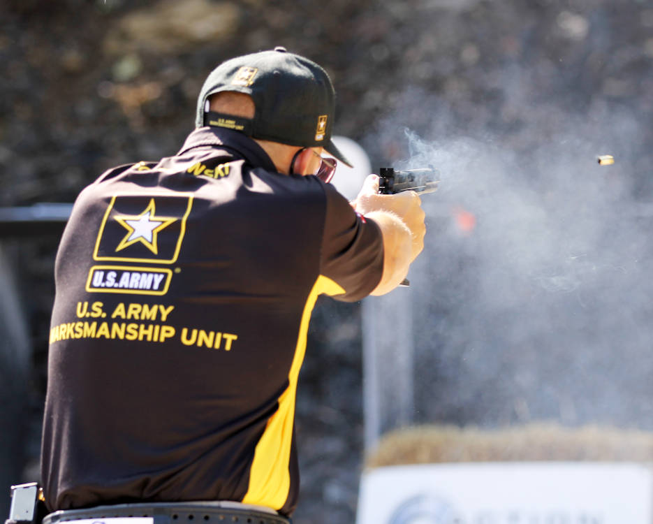Sgt. 1st Class Adam Sokolowski, a Somerville, New Jersey native with the U.S. Army Marksmanship Unit's Service Pistol Team, fires his pistol during The Falling Plate Event at the 2018 Bianchi Cup Multigun Match in Columbia, Missouri May 22. The three-day, four-event action pistol competition drew more than 160 competitors from eight countries and 33 states. Sokolowski claimed 1st Place in the not only the Multigun Match but the overall Bianchi Cup by seizing the Open Division and making history as the first shooting sports athlete in 40 years of the competition to win all three divisions—Production, Metallic and Open—in three consecutive years. (U.S. Army photo by Maj. Michelle Lunato)