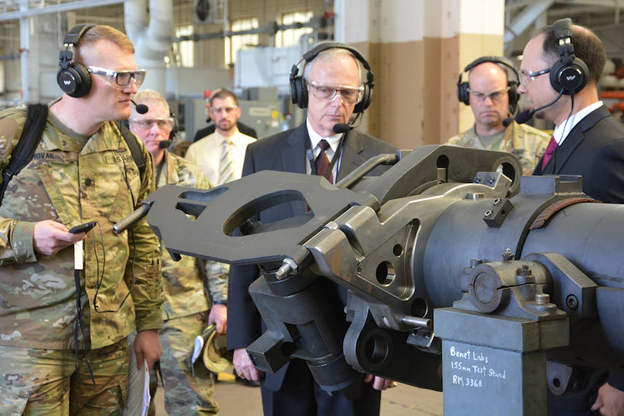 Army Benet Laboratories' Nathaniel Klein, right, briefing Lt. Col. Joseph Novak, left, and Assistant Secretary of the Army Bruce Jette, center, about the product improvements for cannon systems on May 8, 2018. Novak is with the Program Executive Office for Ground Combat Systems. (U.S. Army photo by John Snyder, Watervliet Arsenal)