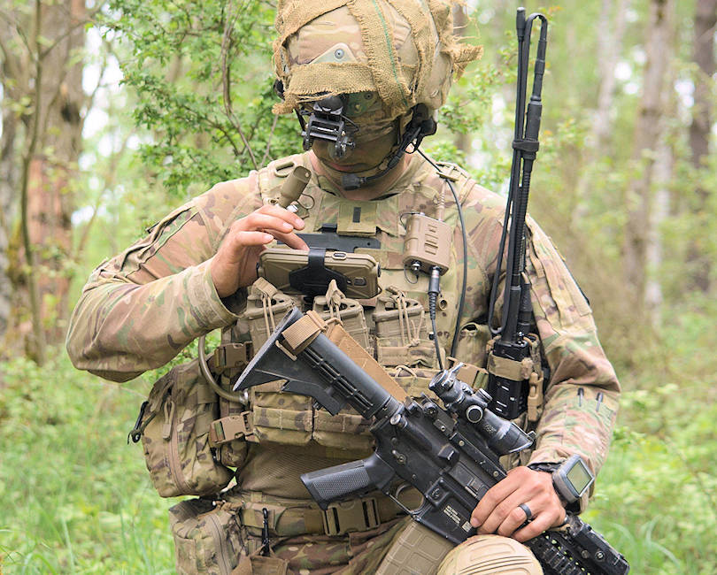 U.S. Army 1st. Lt. Michael Austin, platoon leader for Attack Co., 1-503rd Inf. Regt., 173rd Airborne Brigade, uses the End User Device to report information to his company commander through the Integrated Tactical Network during a live-fire exercise in Grafenwoehr, Germany, May 2, 2018. (U.S. Army photo by Spc. Joshua Cofield)