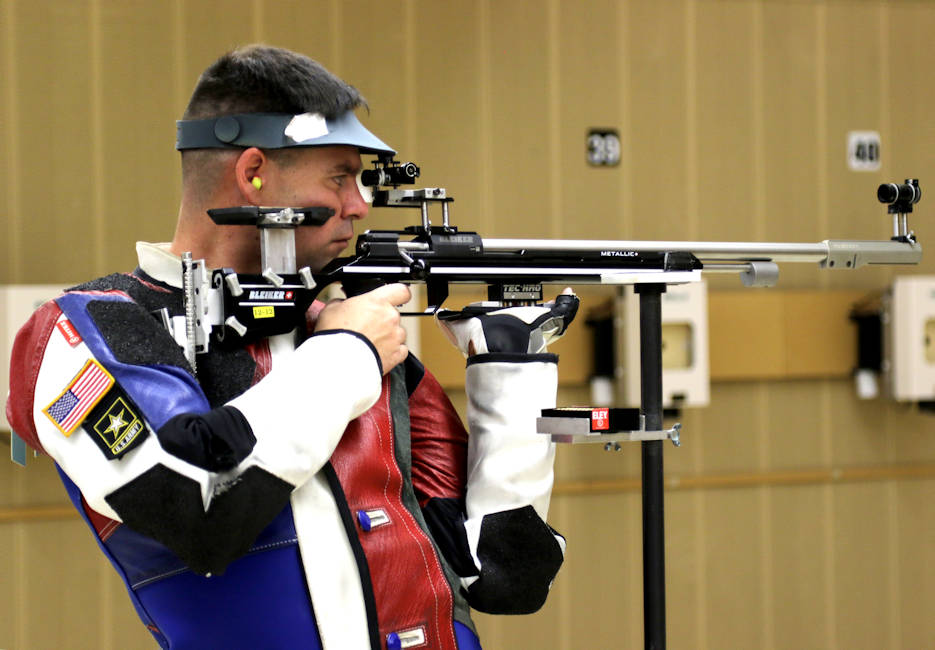 Sgt. 1st Class Michael McPhail, with the U.S. Army Marksmanship Unit's International Rifle Team, fires in the standing position during a Men's 3-Position Rifle Match at the Robert Mitchell Rifle Championships in Colorado Springs, Colorado on February 20, 2018. The former Prone specialist claimed the Bronze Medal at the end of the week-long competition. McPhail, a Darlington, Wisconsin native, competed in the 2016 Rio Olympics and has been a part of the Army's unique marksmanship unit for 14 years. (U.S. Army photo by Major Michelle Lunato)