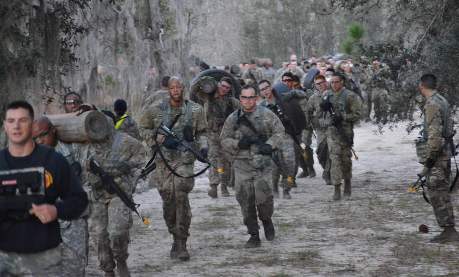 Students from Basic Leader Course 04-18 at Fort Stewart, Ga., run together coming back from the equipment pickup site during the cycle's equipment run on March 2, 2018. The equipment run promotes squad-level cohesion that has Soldiers working together to complete the mission by enduring the added weight and stress of the equipment as a unit rather than individually. (U.S. Army photo by Sgt. Joseph Truckley, 50th Public Affairs Detachment, 3rd Infantry Division)