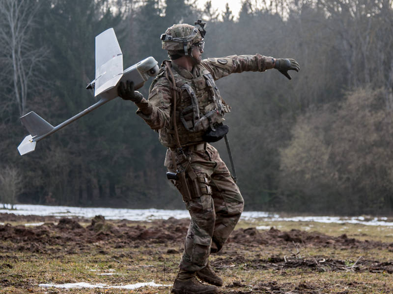Spc. William Ritter, a military policeman with 287th Military Police Company, 97th Military Police Battalion, 89th Military Police Brigade, Fort Riley, Kansas, prepares to launch the RQ-11 Raven, small unmanned aerial system (SUAS), into the air during Allied Spirit VIII at Hohenfels, Germany, Jan. 26, 2018. Roughly 4,100 troops from 10 nations are participating in Allied Spirit VIII, a multinational training exercise designed to test participants' readiness and capabilities. (U.S. Army photo by Spc. Dustin D. Biven / 22nd Mobile Public Affairs Detachment)