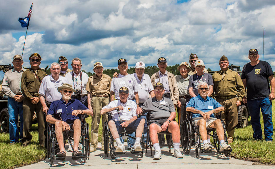Soldiers of the 66th Infantry Division pose for a group photo during the 66th Infantry Division's final reunion and site dedication, held at Camp Blanding Joint Training Center's museum on June 15, 2018. The 66th ID was activated in 1943 at Camp Blanding, Fla., where they conducted their initial training. Afterwards, they traveled to England where they encountered resistance from the German forces before finally settling in Koblenz, Germany in 1945. While in Germany, the conducted occupation duty and provided security at German POW camps. (U.S. Army Staff Sgt. Christopher Vann, Florida National Guard Public Affairs Office)
