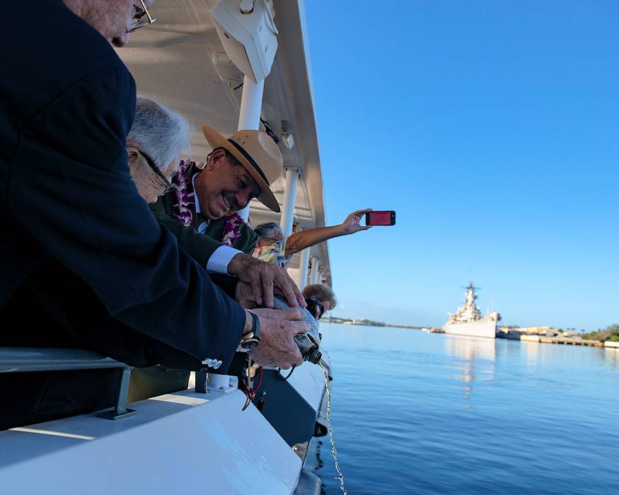December 6, 2018 - Daniel Martinez, National Park Service Chief Historian, (Right) and Hiroya Sugano, M.D. (Left) pour bourbon whiskey into the waters to pay their respects to the lost service members during the 'Blackened Canteen' ceremony at the USS Arizona Memorial. The blackened canteen, which was pulled from the ashes during World War II, is seen as an inspiration for peace. Its blackness and heat-distorted shape represent the inevitability of conflict, yet its presence represents eternal hope for a future of peaceful understanding and reconciliation between former enemies. . (U.S. Navy photo by Mass Communication Specialist 2nd Class Cole C. Pielop)
