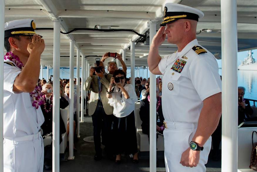 December 6, 2018 - Members from the Japanese Maritime Self Defense Force and the U.S. Navy render a salute to show respect between the two militaries during the 'Blackened Canteen' ceremony at the USS Arizona Memorial. The blackened canteen, which was pulled from the ashes during World War II, is seen as an inspiration for peace. Its blackness and heat-distorted shape represent the inevitability of conflict, yet its presence represents eternal hope for a future of peaceful understanding and reconciliation between former enemies. (U.S. Navy photo by Mass Communication Specialist 2nd Class Cole C. Pielop)